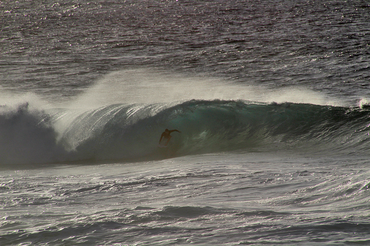 A surfer getting barrelled at Pipeline.